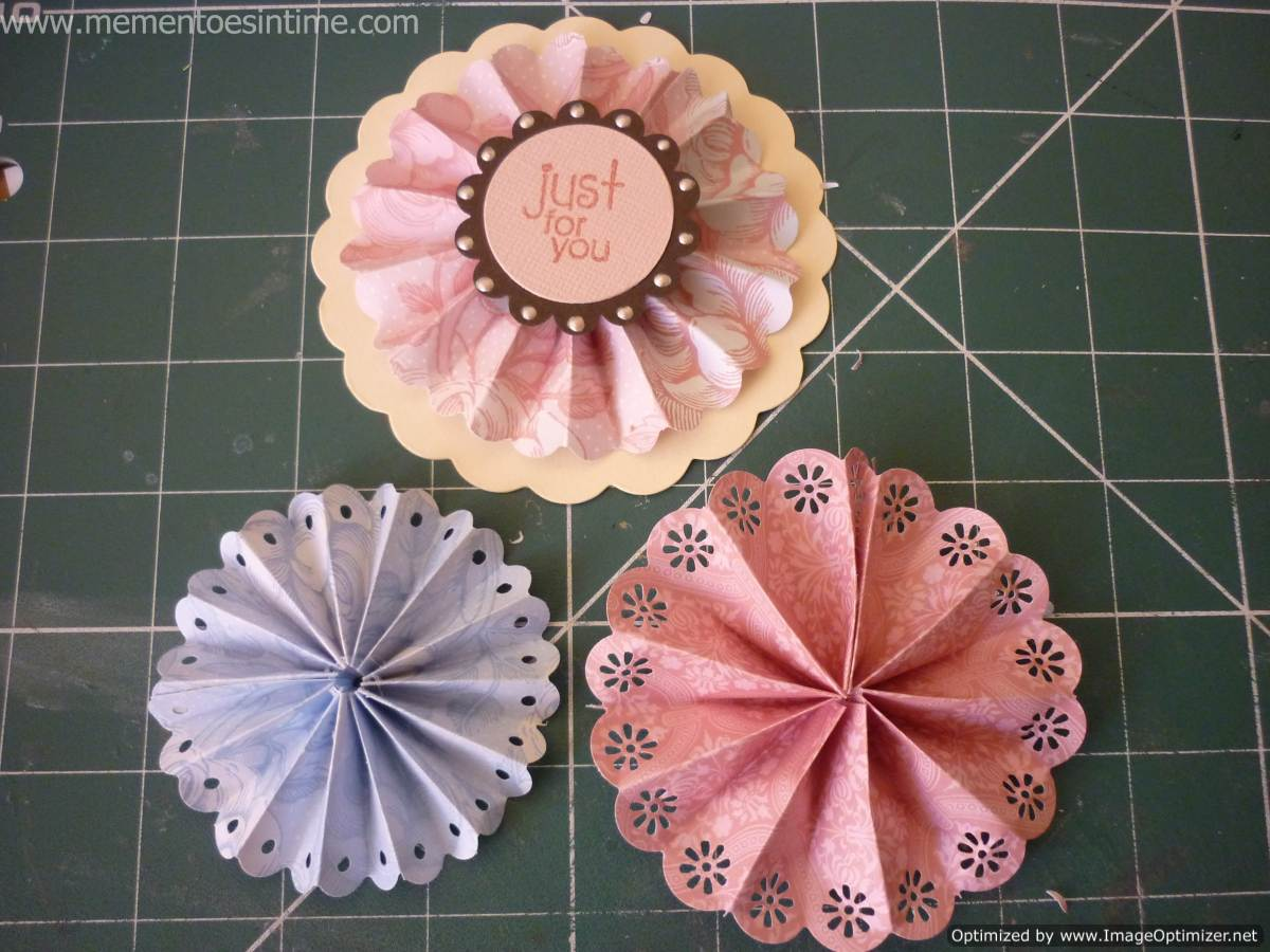 How to make paper roses and rosettes mementoes in time the rosette has been mounted onto a large scallop and can be used as a lovely gift tag or present topper mightylinksfo Choice Image